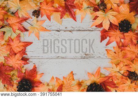 Autumn And Fall Season Background. Fake Maple Leaf On Wood Table. Harvest Cornucopia And Thanksgivin