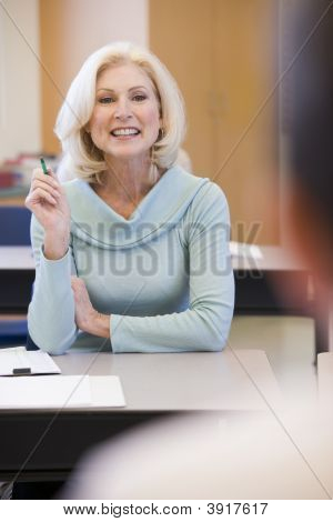 Adult Student In Class With Teacher (Selective Focus)
