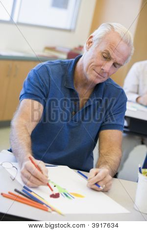 Adult Student In Class Drawing Picture