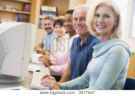 Five People At Computer Terminals In Library (Depth Of Field)