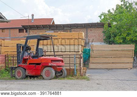 Forklift Truck And Plank Wood Material Storage