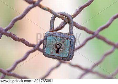 Rusty Love Symbol Padlock Locked At Fence