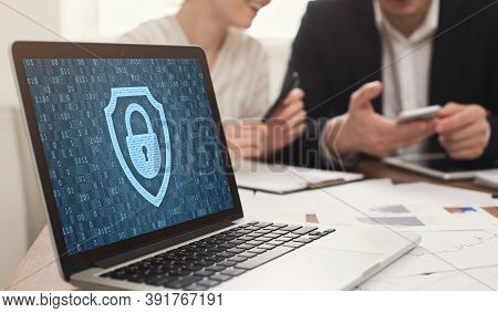 Data Protection And Corporate Cyber Security Concept. Laptop With Closed Padlock Icon And Binary Cod