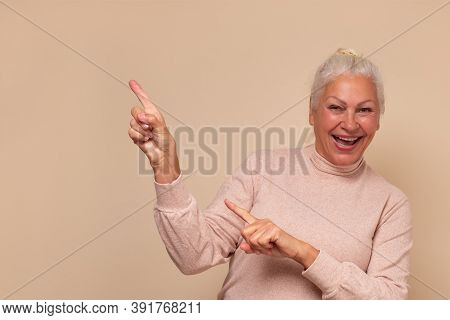 Amazed Excited Mature Old Woman Pointing At Copy Space Aside. Cheap Price Offer.