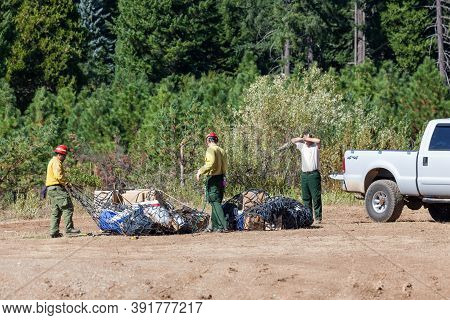 Prospect,  Oregon / Usa - September 9, 2014:  Wildfire Fighting Support Teams Receive Supplies Dropp