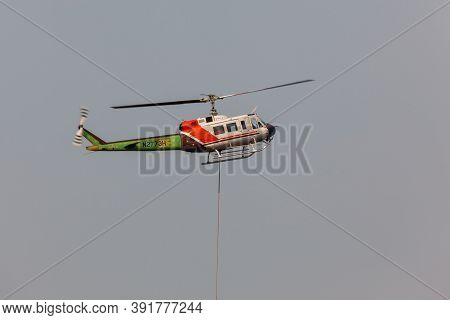 Prospect,  Oregon / Usa - September 13, 2014:  A Fire Fighting Helicopter Takes Off In A Smoke Fille
