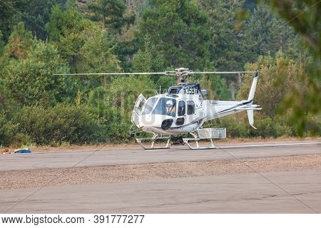 Prospect,  Oregon / Usa - September 13, 2014:  A Small Rescue Helicopter Prepares To Take Off From T