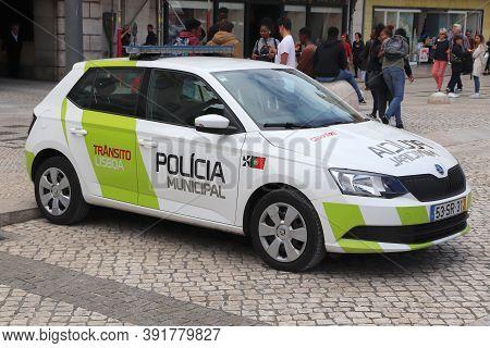 Lisbon, Portugal - June 4, 2018: People Walk By Skoda Fabia Car Of Municipal Police In Lisbon, Portu