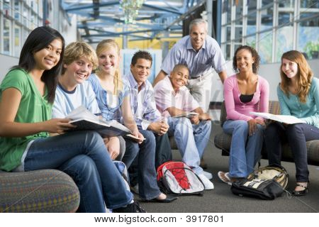 Students Study Group With Teacher