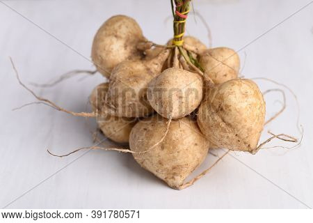 Fresh Jicama Or Yam On White Background, Jicama Can Be Eaten Raw Or Cooked, The Taste Are Crisp, Jui