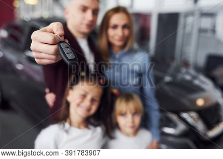 Focused View Of Man With His Family Holds Keys Of New Automobile.