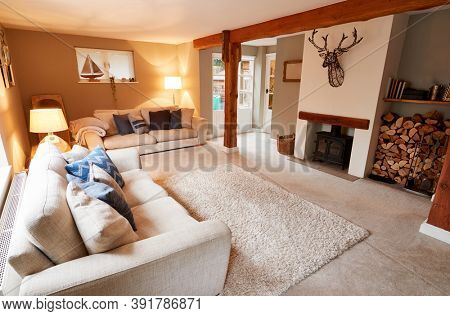 Interior View Of Beautiful Lounge With Sofas And Log Burner In Family House