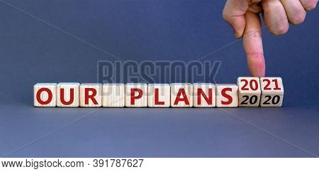 Hand Turns Cubes And Changes The Expression 'our Plans 2020' To 'our Plans 2021'. Beautiful Grey Bac