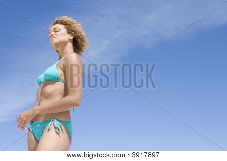 Young Woman In A Two Piece Bathing Suit