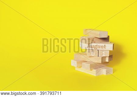 August 1st . Day 1 Of Month, Calendar Date. Wooden Blocks Folded Into The Tower With Month And Day O