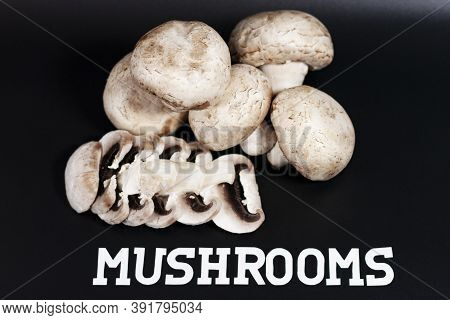 In The Center Of The Screen Is A Pile Of White Champignons. Some Of Them Are Cut Into Slices. The Vi