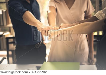 Business People Teamwork Meeting And Fist Bump Show Power Of Synergy For Success In Job At Workplace