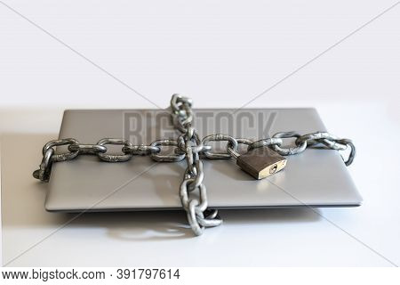 Laptop Surrounded By Chain With Padlock For Digital Detoxification.