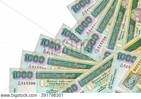 1000 Sri Lankan Rupees Bills Lies In Different Order Isolated On White. Local Banking Or Money Makin