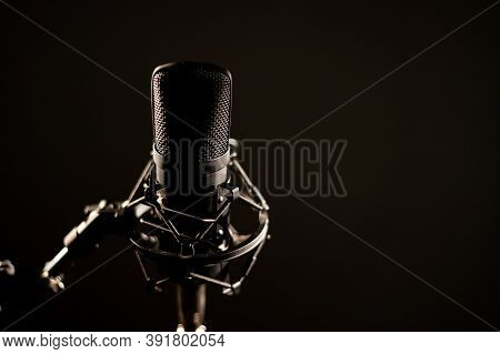 Close-up Of A Professional Microphone For A Radio Broadcast On A Black Background. Recording Studio