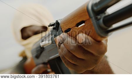 Concept Of Terrorism. Rebel Soldier Aiming At Targets With An Ak-47 Machine Gun. Close Up. High Qual