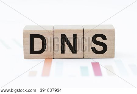 Dns, Domain Name System On The Table Against The Background Of Colored Charts