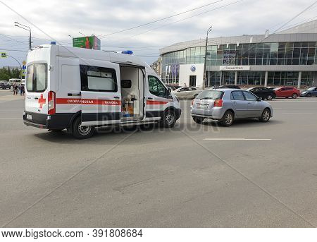 Russia, Chelyabinsk, 08/20/2020 An Ambulance Car With Open Doors Is On A City Street On A City Stree