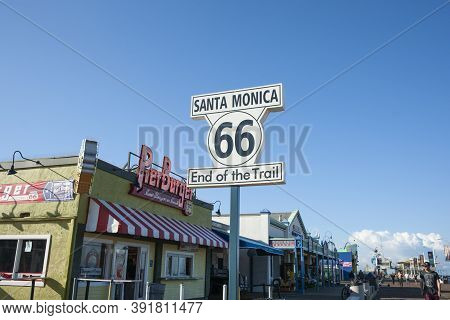 Los Angeles Usa _october 6 2015; Route 66 Santa Monica  End Of Trail Sign On And Pier Burger Neon Un