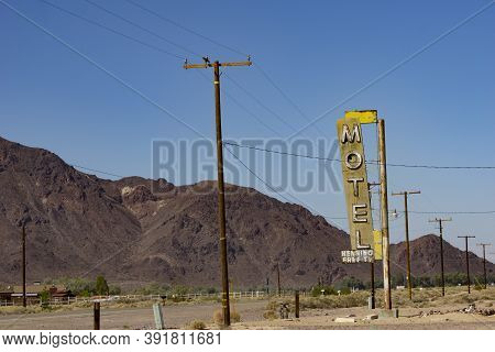 Henning Usa - October 2 2015; Old Motel Sign Along Highway On Part Route 66 Standing Among Parallel