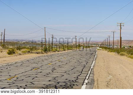 Cracked And Crazed Mosaic Like Mesmerizing Pattern On Road Route 66 Road Surface, California, Usa.