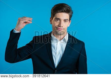 Handsome Bored Business Man Showing Bla-bla-bla Gesture With Hands And Rolling Eyes Isolated On Blue