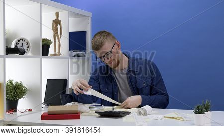 Young Handsome Millenial Checking Bunch Of Bills For Utility Bills, Loans, Consumer Spending, Tuitio