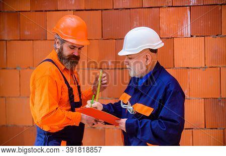 Workers In Helmet. Two Repairman On Construction. Advertising. Repairman. Builder In Construction He
