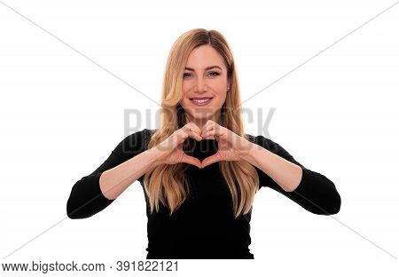Beautiful Woman Shows Heart Sign With Her Hands. On White Background.