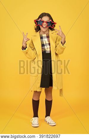Party Girl. Happy Child Make Victory Hand Gestures. Little Kid Celebrate Victory Yellow Background.