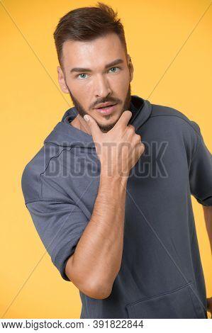 Beard Concept. Handsome Man Touch Beard With Hand. Bearded Man With Beard On Unshaven Face. Beard Gr