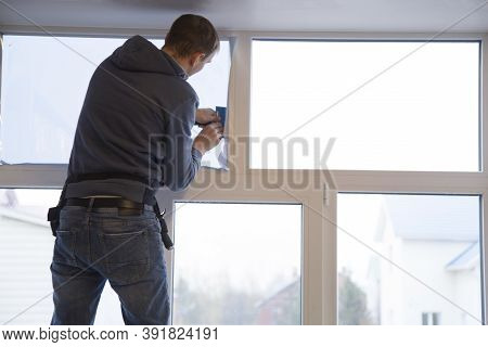 Installing Window Film In The Office. Protection From Ultraviolet Radiation. Protective Film.