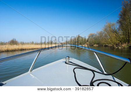 Little motorboat in Dutch Biesbosch nature