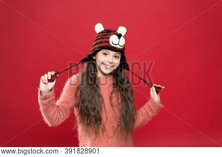 Time For Fun. Kid In Hat With Ear Flaps. Child In Knitted Sweater. Happy Childhood. Happy Teen Girl