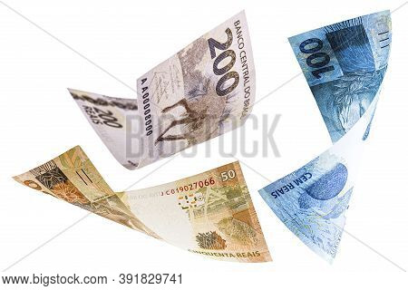 Many Banknotes From Brazil Falling On White Background, Two Hundred, One Hundred And Fifty Reais In