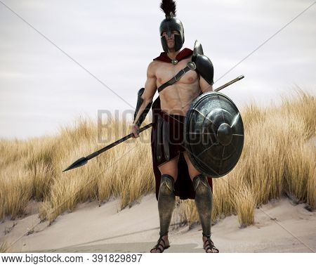 Portrait Of A Battle Hardened Greek Spartan Male Warrior Equipped With A Spear And Shield Ready For