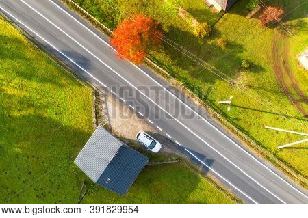 Aerial View Of Beautiful Road In Green Hills At Sunset In Autumn. Colorful Landscape With Rural Road