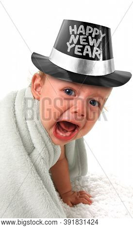 Ten month old baby boy crying and wearing a happy New Year tophat. 2021