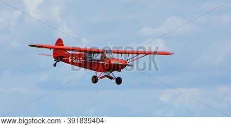 Ickwell, Bedfordshire, England - September 06, 2020: Vintage 1961 Piper Super Cub In Flight Close Up