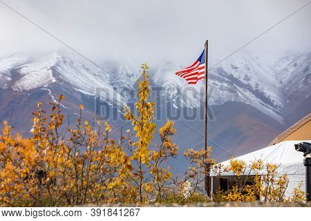 Usa Flag Proudly Raised At Denali National Park Station In Alaska