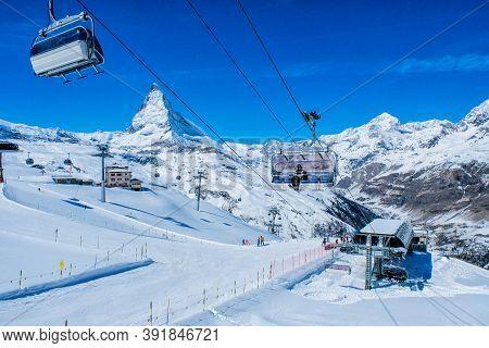 Zermatt, Switzerland March 25, 2017: Skier In Cable Car To Matterhorn Glacier Paradise At Zermatt, S