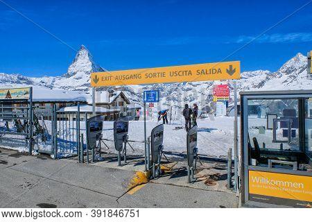 Zermatt, Switzerland- March 28, 2017: Skiing With Zermatt Staion As Background In Winter Season.the