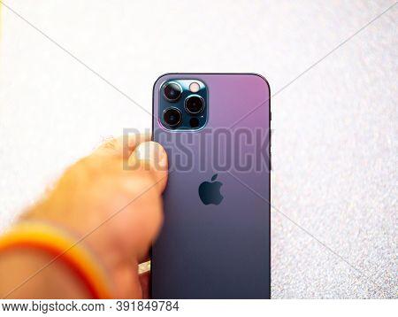 Paris, France - Oct 23, 2020: Pov Man Holding New Iphone 12 Pro Max 5g Smartphone Model By Apple Com