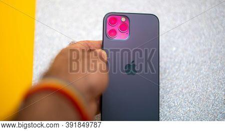 Paris, France - Oct 23, 2020: Magenta Futuristic Colro Cast On Lidar And Triple Camera Of New Iphone