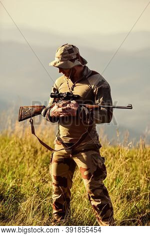 Army Forces. Man Military Clothes With Weapon. Brutal Warrior. Rifle For Hunting. Ready To Shoot. Hu